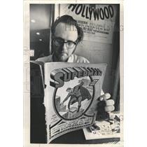 1973 Press Photo Clark Kent peruses memento Man Steel - RRW48069
