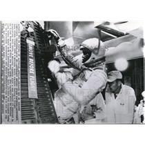 1961 Press Photo Astronaut John Glenn climbs into Mercury space capsule