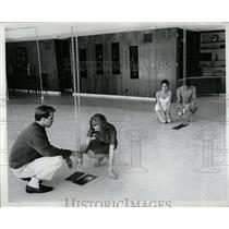 1963 Press Photo Swimming pool cover - RRW02573
