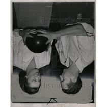 1946 Press Photo Man Showing Woman Bowling Technique - RRW13181