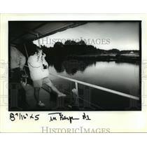 1991 Press Photo Bayou Bonfuca - Tourist Takes a Photo, Slidell, Louisiana