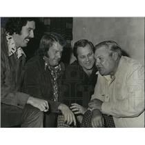 1975 Press Photo Coaches entertained by one another's stories. - abns00026