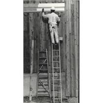 1967 Press Photo Workman painting at Astroworld, Texas - hca00401