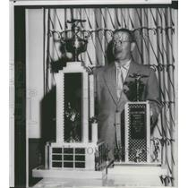 1957 Press Photo Boat racing champ, Joe Taggert, poses with trophies - sps12556