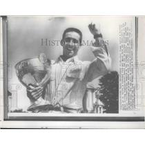1957 Press Photo Boat racer Jack Regas smiles after winning the President's Cup
