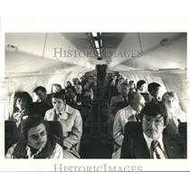1987 Press Photo Passengers inside an Aircraft  - hca04743