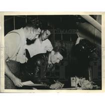 1938 Press Photo NY Douglas Corrigan signs release for flight as Scholer watches