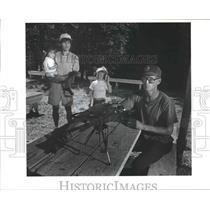 1990 Press Photo Hunter Erickson holding a 243 rifle at Farragut State Park.