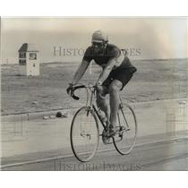 1976 Press Photo Lone Man Riding a Bicycle on the Road - noa36111