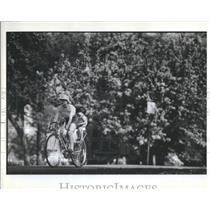 1982 Press Photo Woman Child Ride Bicycle Spring Day Ch- RSA39267