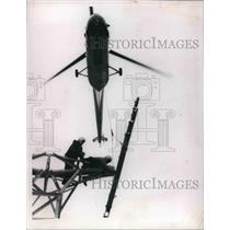 1966 Press Photo Helicopter Assists Workers & Serves As A Crane At Glen N.H