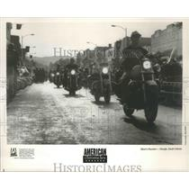 1990 Press Photo Line of bikers coming down street, Sturgis South Dakota