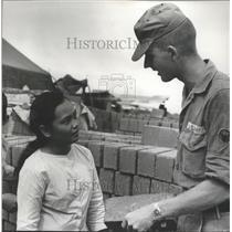 1967 Press Photo Worker and Advisor Check Brick in Vietnam