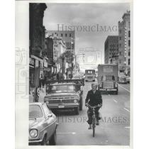 1976 Press Photo Mrs. Henry Reuss rides bike to work in the district - mjb73859