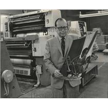 1969 Press Photo Charles A. Petri, examines press work for Jos. Schlitz Brewing