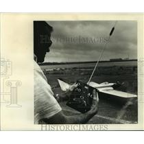 1964 Press Photo Jerry Kelly with a radio transmitter for radio control plane