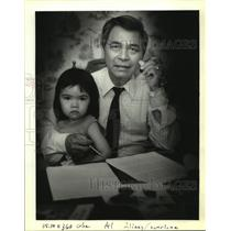 1992 Press Photo Kiem Do sits with his manuscript, papers, and granddaughter.