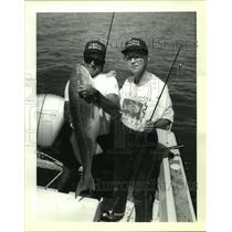 1992 Press Photo Fisherman Jill Easton With a Red Bullfish At Cocodrie