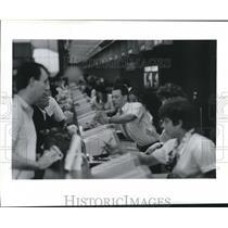 1989 Press Photo Agents at Intercontinental Airport Main Ticket Counter.