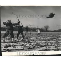 1957 Press Photo Men with bows hunt pheasant. - mjb99133
