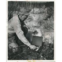 1959 Press PhotoThomas L Carpenter puts crow calling record on to attract birds