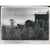 1950 Press Photo Column of smoke rises from bridge blown up by South Koreans