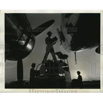 1942 Press Photo An airliner is loaded with cargo including vital war materials