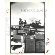 1981 Press Photo Crop Dusting employees load fungicides into plane - hca16958