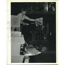 1990 Press Photo Mark Lawson stocks Fritchie Park Pond with rainbow trout.