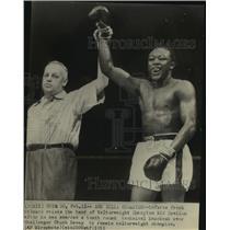 1953 Press Photo Boxer Kid Gavilan in Ring with Referee Frank Gilmore at Win