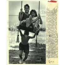 1988 Press Photo Mitzi Martinez and Toni Savoy get a push from Jessica Dowdy.