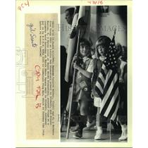 1988 Press Photo Valerie Walker and Alexis Martin present flags for Flag Day.
