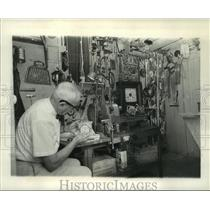 1963 Press Photo Grindle in his workroom- woodworking and clock-making hobbies