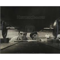 1971 Press Photo Marlin Culwell studying John Clay's Soap Box Derby Car