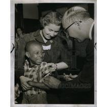 1955 Press Photo Ernest receives shot at school - RRX49785