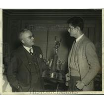 1944 Press Photo West End football player Jim Burns gets trophy from Ed Norton