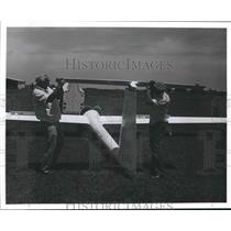 1977 Press Photo Two men work on glider - hca23692