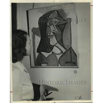 "1949 Press Photo Picasso painting ""Portrait of a Woman"" viewed by visitor."