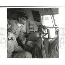 1969 Press Photo Ice Observers aboard Hercules Aircraft for ice patrol missions