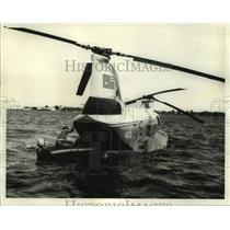 1964 Press Photo A Royal Canadian Air Force helicopter retrieves an injured man