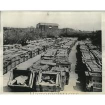 1935 Press Photo Arms shipment that arrived in France switched for paving stones