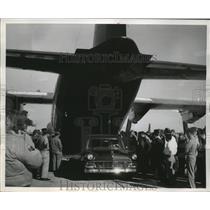 1957 Press Photo A car emerging from cargo cavity of C-130 Lockheed Hercules