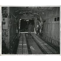 1857 Press Photo The unloading scene of crane cab from Lockheed C-130 plane