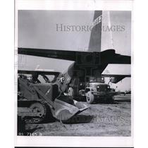 1957 Press Photo Lockheed Hercules Transport moving U.S Road Building Machine