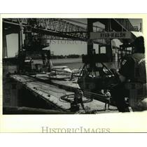 1994 Press Photo A Beachcraft twin-propeller plane is loaded onto a bardge