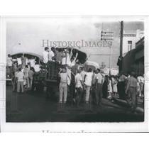 1963 Press Photo Cubans on Russian-made trucks on a street in Havana, Cuba