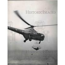 1955 Press Photo Helicopter Hoists Lieutenant Ridley Over Water, England