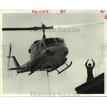1980 Press Photo Man directs helicopter in Houston landing - hca28213