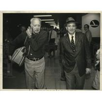 1984 Press Photo Robert Aline and Henry Nofal walk from Gate 6, Albany Airport