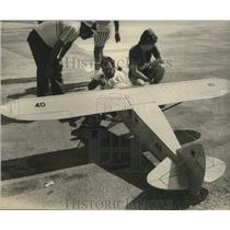 1951 Press Photo Martell adjusts the motor of Mr Mulligan's Model Plane
